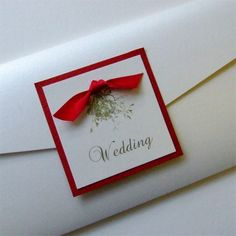 Pocketfold Wedding Invitation with printed mistletoe and satin ribbon bow. Featured in White Micah and Jupiter Red with a red satin ribbon. £3.95 available to purchase online.