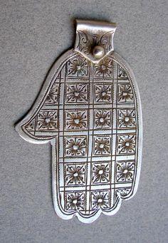 A Hamsa, aka Hand of Fatima pendant.   Silver