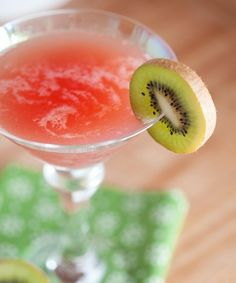 Two tart, refreshing fruits collide in this delightful drink: Cranberry Kiwi Martini. #martini #cranberry #kiwi #food #drinks #cocktails