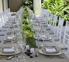 Grey and green make a lovely, soft combination that fits right in with a tropical wedding! gray weddings, table settings, wedding themes, grey weddings, sandal, tropical weddings, green weddings, linen, destination weddings