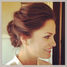 Light wispy texture pulled back into a chignon.