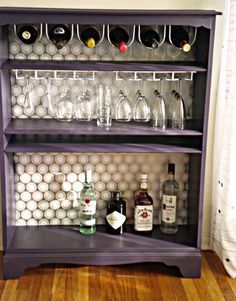 How To: Turn a Bookcase Into a Bar || id do a few different things (probably wouldnt do the wrapping paper on the back and if i did, id mod podge it; would spray paint the bottle and glass holders; would make two shelves for the wine), but absolutely love the idea.