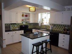 White cabinets, black appliances