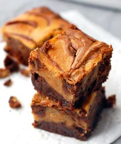 Dying over these Peanut Butter Cheesecake Brownies from fourseasonsrecipes.com!