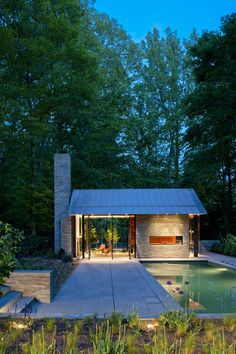 glass-walled pool house with fireplace