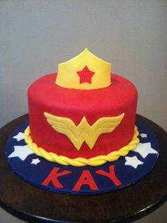 Wonder Woman Cake - Chocolate  cake with peanut butter buttercream.  The cake and board are covered in modeling chocolate and all details are modeling chocolate. Model Chocol, Chocolates, Cake Cover, Cake Idea, Cake Pop, Children Cake, Birthday Cake, Peanut Butter, Chocolate Cakes
