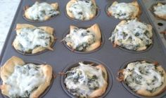 More Easy Thanksgiving Appetizers - I am totally making these spinach artichoke bites next week for Thanksgiving