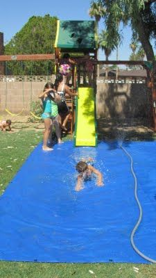 Place a tarp under or at the bottom of slide, set up sprinkler to keep slide and tarp wet…hours of water fun! Remember for next summer!