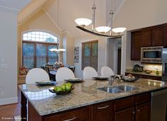 Kitchen island in The Rochelle, plan 1204. http://www.dongardner.com/plan_details.aspx?pid=3506. #Kitchen #Island #Home