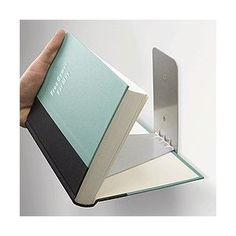 "Conceal Invisible Bookshelf, $19.90 from Amazon. Reader Kate says, ""For those of us nerds who just have too many books. AND, they make great decoration!"""