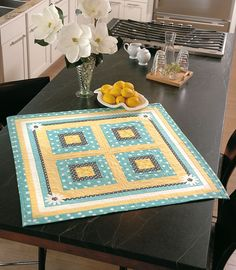 Brighten your home for spring with one of the four table toppers included in Love of Quilting Mar/Apr '12. This table topper is Spring Daisies by Nancy Kirkland.