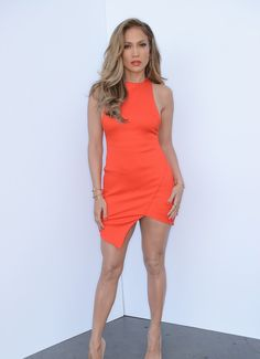 celebstarlets: JLO looks amazing in this neon red orange dress  5/8/14 - Jennifer Lopez arriving to 'American Idol' in Hollywood.