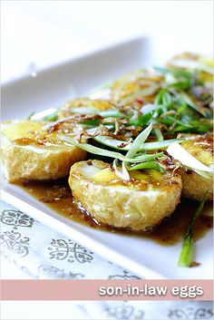 Son-In-Law Eggs  -  The eggs are first hard-boiled, deep-fried, and then topped with tamarind sauce.