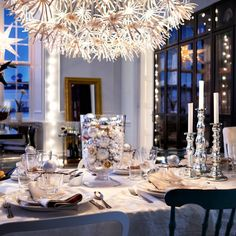 Make your table shimmer    Set a party atmosphere and decorate your Christmas table with glass hurricane lanterns filled with glimmering silver baubles surrounded by plenty of glowing candles. Mix and match Christmas decorations for a laid-back yet elegant feel.