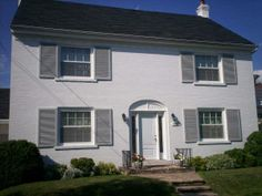 White painted house with French grey shutters