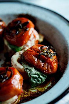 Roasted Caprese tomatoes Ingredients •4 large, ripe tomatoes •1 tablespoon olive oil •2 tablespoons Balsamic vinegar •1 teaspoon sugar (optional) • kosher salt  pepper to taste •4 thin slices Mozzarella •4 basil leaves  for the dressing •small handful fresh basil •1 garlic clove •juice of ½ lemon •2 tablespoons olive oil • kosher salt to taste