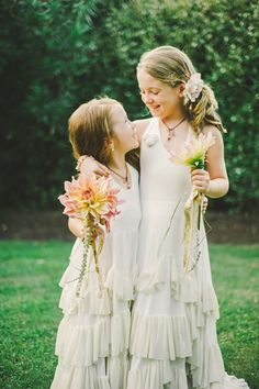 flower girls in ruffled dresses // photo by Connection Photo // http://ruffledblog.com/glittery-outer-banks-wedding