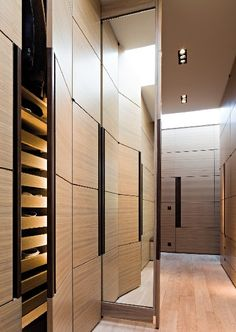"""Cupboard space, concealed drawers behind them and full length, double sided sliding """"pocket"""" mirror! Great idea"""