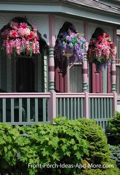 "A ""Painted Lady"" front porch with baskets. Found on Front-Porch-Ideas-and-More.com #porch ❤❦♪♫"