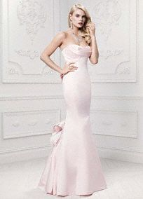 Contemporary, timeless and chic, this long and luxe mermaid gown puts an unquestionable twist on sophistication!  Satin mermaid gown with ultra-feminine draped neckline and sculpted bodice.  Features eye-catching fabric manipulation on the back of the gown.  Sizes 0-14. Available in Petal.  Fully lined. Center back zip. Imported polyester. Dry clean only.  To protect your dress, try our Non Woven Garment Bag.