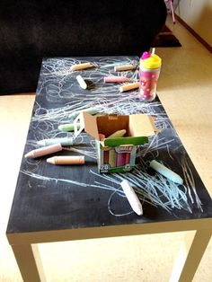 pick up an old coffee table and paint with chalkboard paint. @Anna María Pablos Tietjen