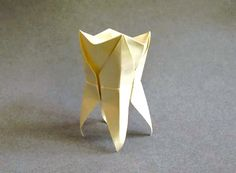 Here's the link to make this origami tooth. http://mysocialpractice.us2.list-manage.com/track/click?u=019001f5279c23378841bfaa1=967523478a=b620256909