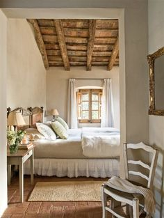 Natural wooden beams and beige bedroom