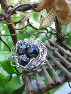 Springtime in Fairy Land - wire is 24 ga non-tarnish silver - fairy chair and nest with cloisonne eggs  (inspiration only)