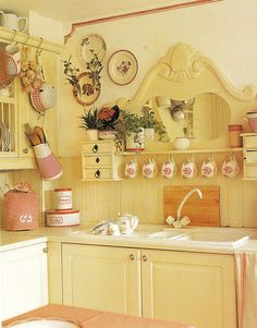 love this repurposed dresser mirror over the kitchen sink.  So charming.  Love the yellow and red color scheme.