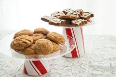 Make these easy cookie stands for your travel treats! They're super-quick, cheap, and easy to make, in case you want something pretty but disposable to take with you to a party so you don't have to worry about getting it back. (Secret: The pedestal is a Solo cup covered in wrapping paper!)