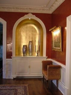 Venetian Plaster walls with gold leaf niche and mica glazed cornice