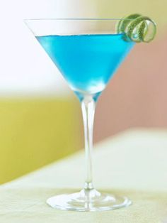 Blue Blue Christmas Cocktail - In a large cocktail shaker, combine vodka, white cranberry juice, blue curacao, lime juice, and ice.