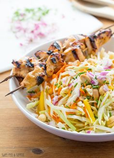 Chicken Satay Salad: crunchy veggies tossed in a sweet and spicy peanut-ginger sauce, and topped with grilled peanut-ginger chicken.  No ove...