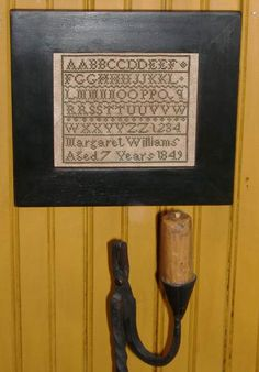 Reproduction on an antique sampler. HomeSpunPrims