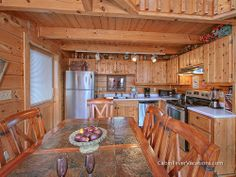 Solid Gold - Beautiful View overlooking Pigeon Forge - Beautifully decorated, custom two-story, log cabin that will comfortably sleep four guests and has all the comforts of home, it is much more than a one bedroom cabin!