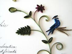 Quilled bird on a vine