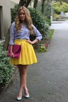 blonde hair, gingham shirt, bright skirt and clutch