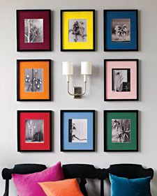 Neat idea....frame black and white photos with colored mats!  You could do multiple colors, a few coordinating room colors or maybe just one coordinating room color.