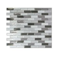 Peel and stick wall tiles. Perfect for the kitchen, no grout needed!