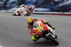 Two of my favorite riders: Rossi and Simoncelli (RIP). Looks like the corkscrew at Laguna (?)