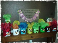 Altered to Perfection: Upcycled Baby Food formula cans painted Angry Birds. Used as centerpieces at the party.