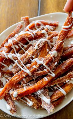 Crispy baked sweet potato fries coated in cinnamon sugar and served with a sweet vanilla icing. I call these fries a potassium-rich dessert!