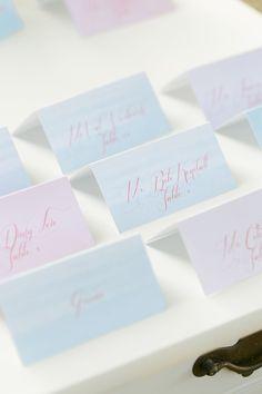 watercolor escort cards, photo by Amalie Orrange Photography http://ruffledblog.com/sangria-inspired-wedding-ideas #weddingideas #escortcard