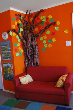 """{Kid Spaces} Reading nook with """"reading tree"""", leaves have names of books children have read."""