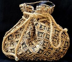 This gorgeous drawstring potli bag/batwa has beavy golden beadwork all ...