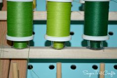 Store Bobbins on a thread rack under their matching spools. Duh.