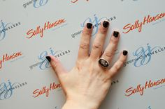 Glittery black nails with a striking Jamie Joseph ring, from Greenwich Jewelers