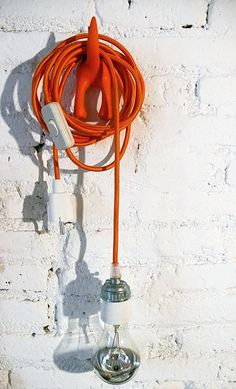 Textile cable lamp with switch and plug orange by lacasadecotο.