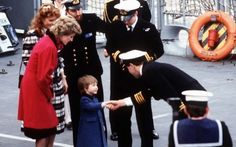 Prince William, 3, shakes hands with the Commander of the Frigate HMS Brazen, Captian Richard Cobbold, watched by his mother, the Princess of Wales (red coat), and the Duke and Duchess of York. The Duke of York served on HMS Brazen as a helicopter pilot.