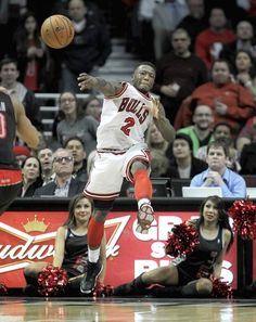 Bulls guard Nate Robinson tries to save a ball from going out of bounds.